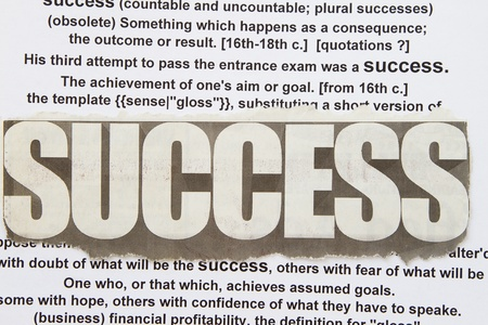 narrative: success word newspaper cutout with success narrative in the background