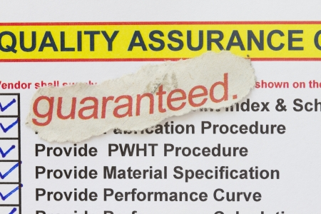 requirement: Quality is guaranteed concept - with check mark on the list requirement of quality control  Stock Photo