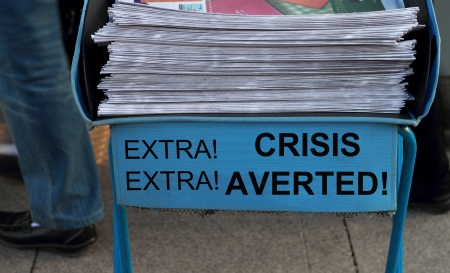 subway entrance: Newspaper stack - take one of these newspaper in the subway entrance  Stock Photo