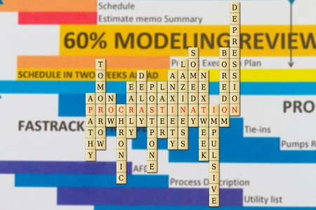procrastination in a word puzzle with schedule background. Stock Photo - 20343602