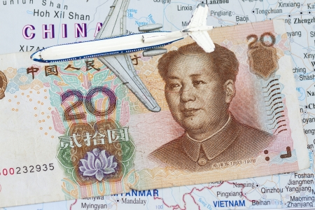 rmb: chinese money background with map of china and toy