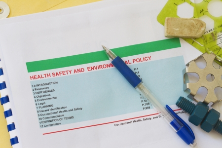 Health,safety and environmental policy with pen  photo