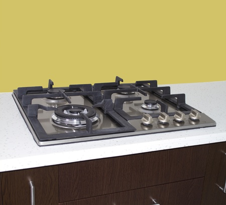 Gas stove  kitchen stove on gas with yellow wall   Stock Photo - 21428784
