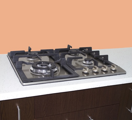 Gas stove  kitchen stove on gas with peach wall Stock Photo - 21428881