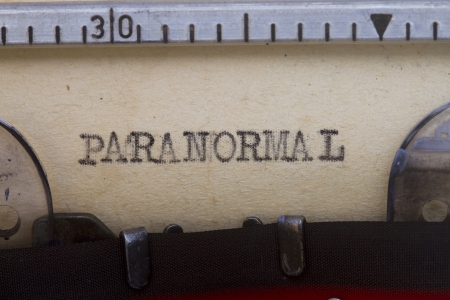 paranormal: Paranormal typewritten in a vintage paper close up shot.