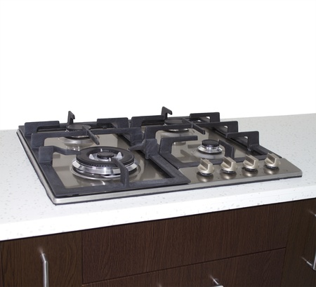 oven range: Gas stove. kitchen stove on gas with peach wall .