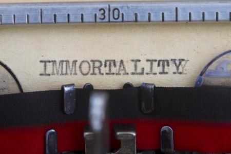 immortality: Immortality typed into vintage paper close-up shot