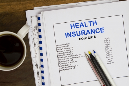 Operating instruction manual stock photo picture and royalty free health insurance with blueprint pen and coffee photo malvernweather Image collections