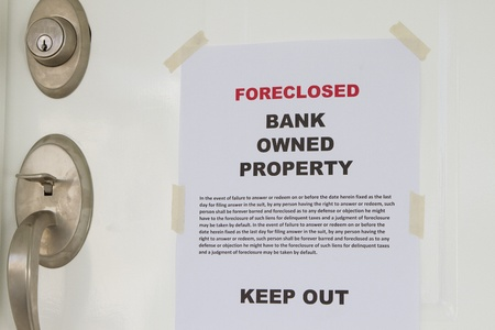 Real estate lender bank owned keep out sign notice Stock Photo