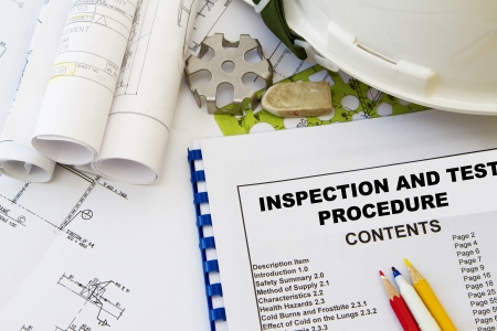 Inspection and test procedure and engineering tools with hard hat. Stock Photo