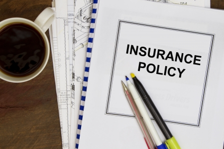 insurance policy form on desk in office showing risk concept  Life; Health, car, travel
