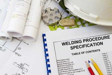 Welding procedure specification and engineering tools with hard hat  photo