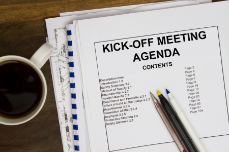 coffee meeting: Kick off meeting agendal with blueprint and coffee