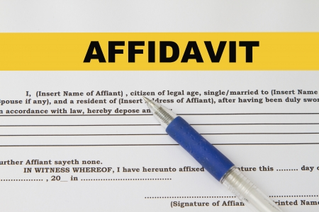 out of focus: Affidavit print out focus on word affidavit with pen