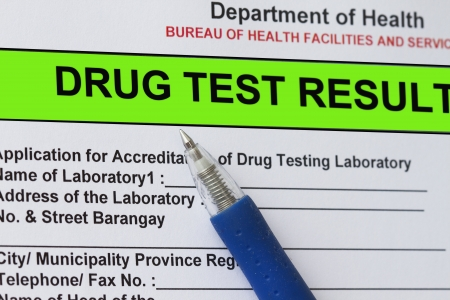drug test: Macro shot of Drug test result form with blue pen