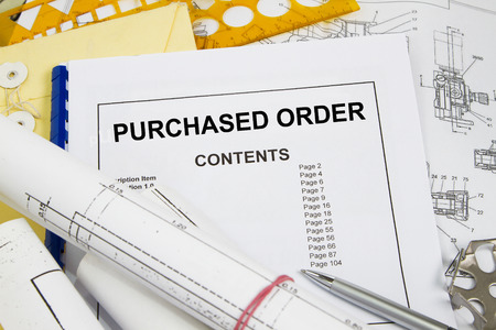 manila envelop: Purchased order with blueprint template and engineering materials  Stock Photo