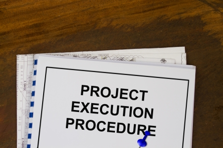 execution: project execution procedure abstract with plans and wood background