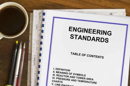 Engineering standards sketch with coffee and blueprints