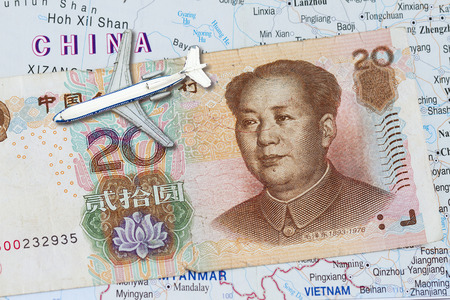 Travel to China and chinese money background with map of china photo