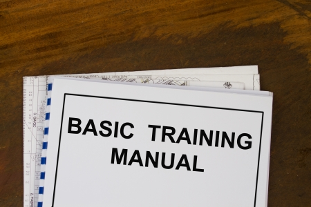 instruction manual: basic training manual with blueprints in a wood texture background  Stock Photo