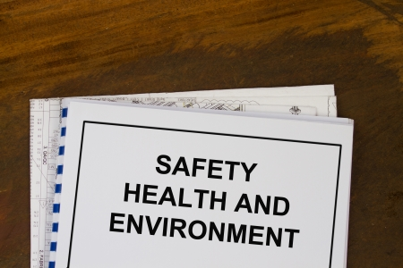 Safety health and environment manual with wood texture background  Stock Photo