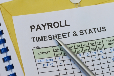 Payroll Weekly timesheet, with pen. Timekeeping record and payroll. photo
