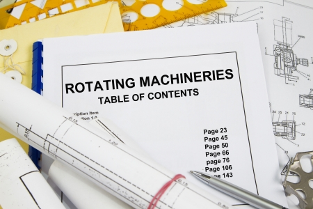 Rotating machineries  manual guide brochure with blueprint and pencil photo