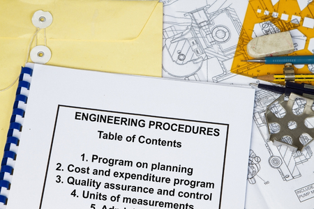manila envelop: Engineering Procedures of a machinery with engineering tools and table of contents Stock Photo
