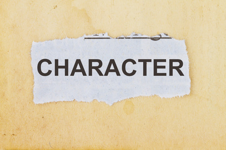 Character newspaper cutout in an old paper background. Stock Photo - 80017662