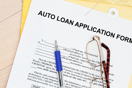 manila envelop: auto  loan application form with manila envelop and pen