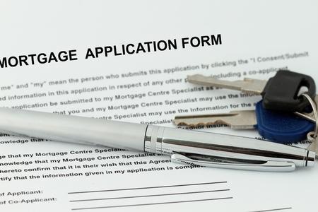 住宅ローンの申し込み書ペンとキー - 金融業界の多くの用途に。 写真素材