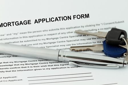 Mortgage Application  form with pen and key - many uses in finance industry.