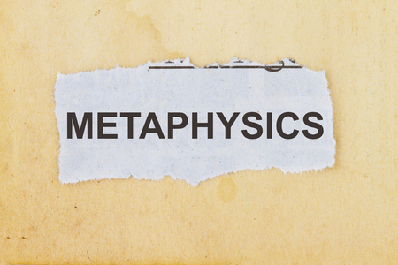 esp: Metaphysics newspaper cutout in an old paper background.