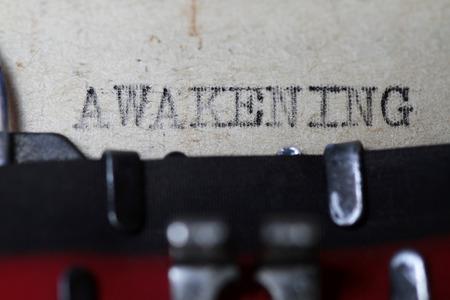 typewriting: Awakening as typed in an old vintage paper macro shot.