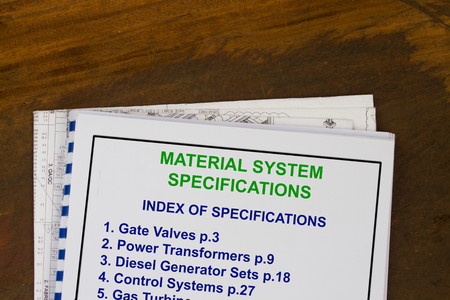 manila envelop: Material System Specifications cover sheet with blueprints in a wood texture background.