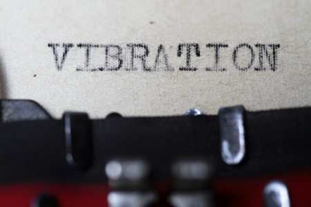 Vibration as typed on an old vintage paper Stock Photo
