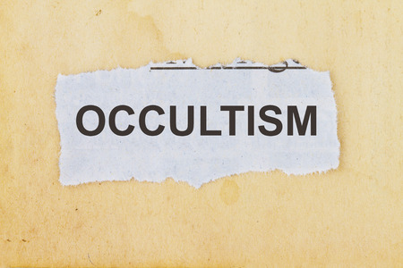 occultism: Occultism  newspaper cutout in an old paper background.