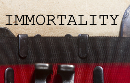 transmute: Immortality  typed on an old vintage paper with od typewriter font.