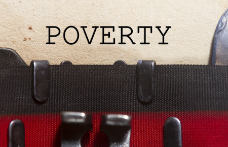 Poverty  typed on an old vintage paper with od typewriter font.