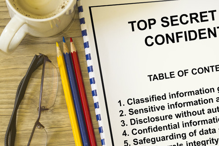 Top secret classified information concept- with contents of lecture on a cover sheet.