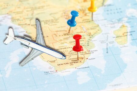 Travel to South Africa with marking push pin and toy airplane  concept .