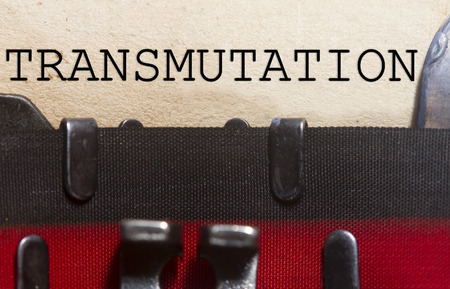 transmute: Transmutation typed on an old vintage paper with od typewriter font.