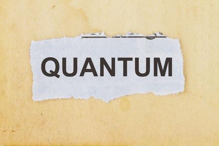 Quantum newspaper cutout in an old paper background.