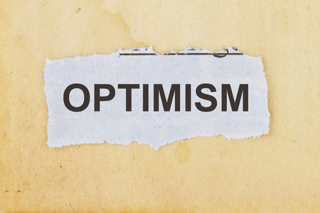 positivist: Optimism  newspaper cutout in an old paper background.