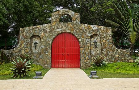 Main entrance of a resort- red door italian design.