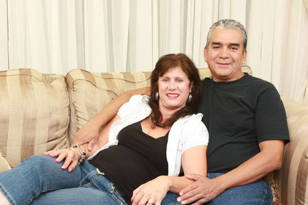 Couple laying on a sofa embracing each other
