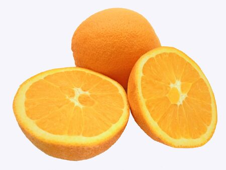 One cut and one whole orange on a white background Imagens