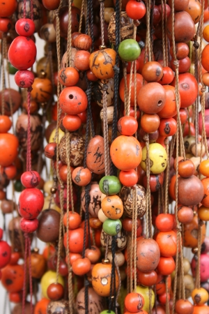 seed beads: Colorful strands of Tagua Beads for sale at the outdoor craft market in Otavalo, Ecuador