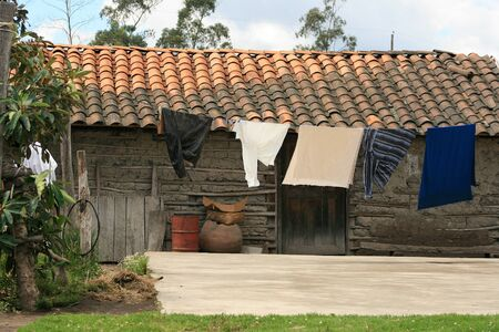 mud house: An old mud and wood farmhouse in the village of Morochos, Ecuador Editorial