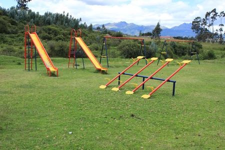 totter: Slides see saws and swings in a childrens park in Cotacachi Ecuador